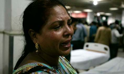 A woman cries after her brother was injured in a suicide attack on a church, at a hospital in Lahore