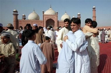 Pakistani Muslims share Eid greeting after offering Eid al-Fitr prayers at the historical Badshahi mosque, Sunday, Oct. 14, 2007 in Lahore, Pakistan. Eid al-Fitr marks the end of Muslim's holy fasting month of Ramadan. (AP Photo/K M Chaudary)