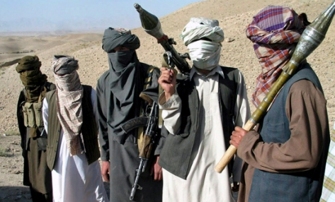 """Face-covered militants who they say are Talibans, pose with RPG and AK47, in Zabul province, southern of Kabul, Afghanistan Saturday, Oct. 7, 2006. A Taliban commander said in a sit-down interview that insurgent fighters will battle """"Christian"""" troops until they leave Afghanistan and a fundamentalist government is established in Kabul, warning that hundreds of militants are ready to launch suicide attacks to again install strict Islamic law. (AP Photo/Allauddin Khan)"""